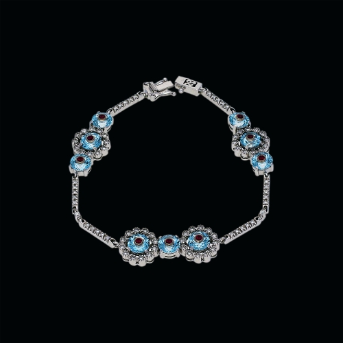 Bracciale tennis fantasia floreale in oro bianco 18 carati, diamanti bianchi,acquamarina e rubini naturali