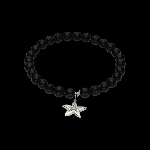 Bracciale elastico con onice nera con pendente in oro bianco 18 carati e diamante bianco taglio brillante
