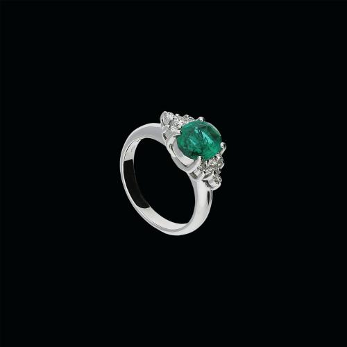 Anello in oro biaco 18 cararti , smeraldo naturale e diamanti bianchi taglio brillante