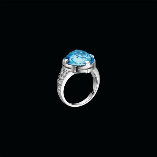 Anello Parentesi in oro bianco 18 carati con diamanti e topazio azzurro centrale