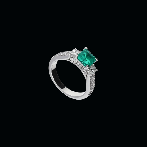 Anello in oro biaco 18 cararti , smeraldo naturale diamanti bianchi taglio princess e taglio brillante sul gambo
