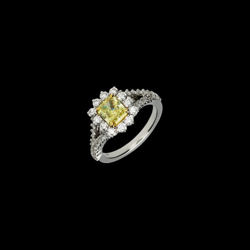 Anello in oro bianco 18 carati con diamanti taglio brillante e diamante fancy yellow taglio cuscino