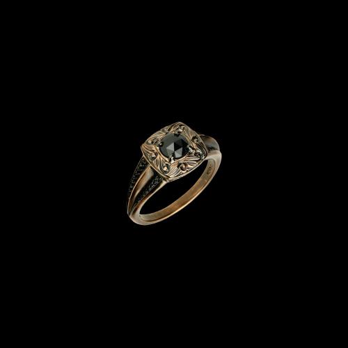 Anelloin oro rosa lavorato e diamanti neri